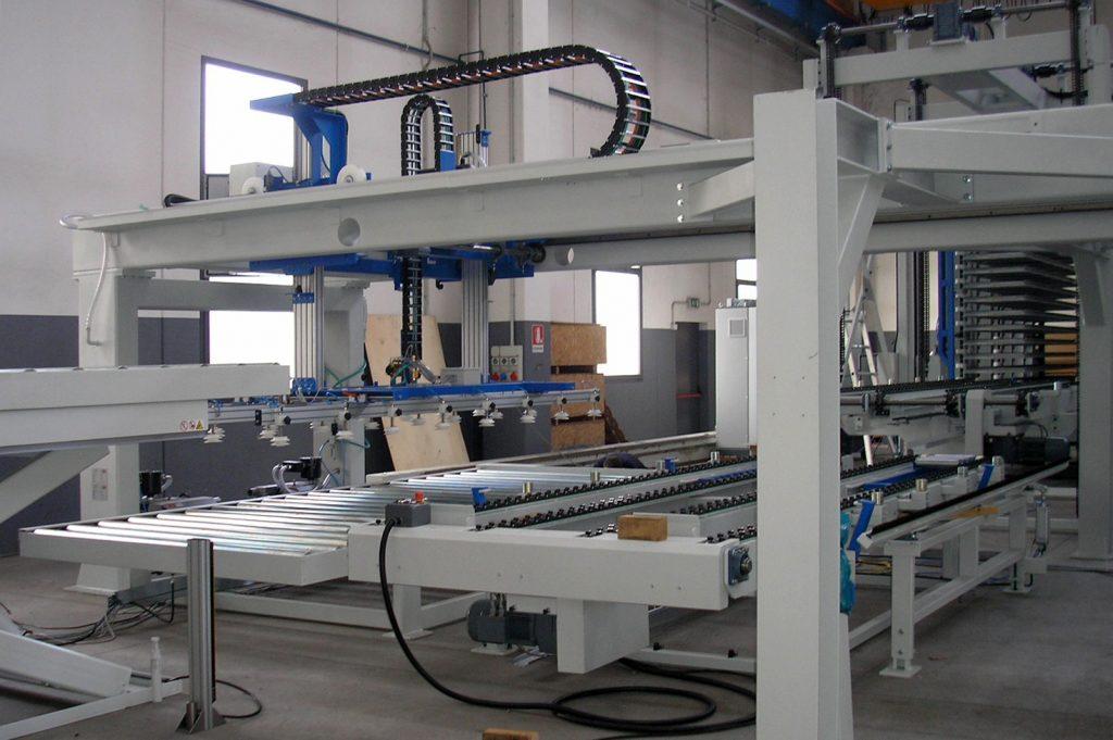 Automazioni impianto pressatura laminati